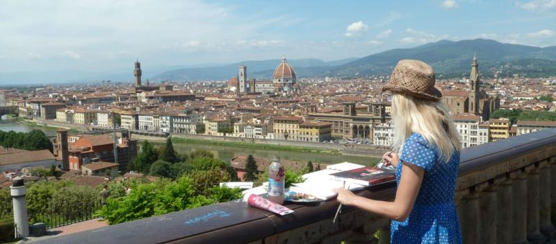 An artist painting the view over Florence, Italy